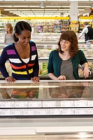 Young women doing shopping in supermarket