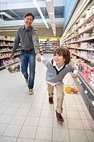 Father with son 6_7 doing shopping