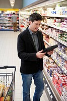 Man doing shopping with digital tablet