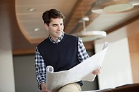 Young male architect at office