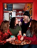 Four friends together at a coffee house