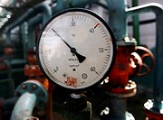 Gas pressure dial at a natural gas processing plant. Natural gas is a fossil fuel obtained from underground deposits. At processing plants, it is clea...