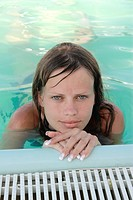 beautiful young Ukrainian girl relaxes in pool