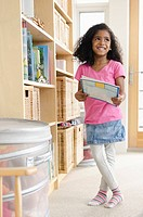 Young girl choosing book to read