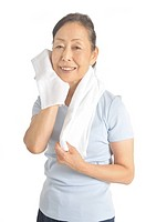 Senior woman wiping off sweat by towel