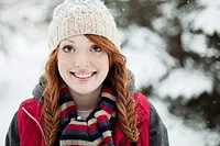 Redheaded young woman enjoying the outdoors (thumbnail)