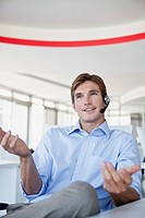 Young smiling businessman with headset