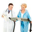 Doctor supervising a fit senior woman as she works out on a treadmill. Isolated on white.