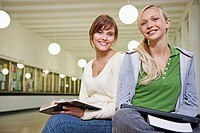 Portrait of two female students in corridor
