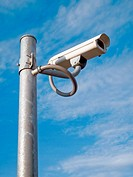 Surveillance Camera mounted on apole steel and blue sky