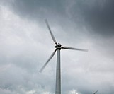 Wind turbine in wind farm on cloudy day in North Wales