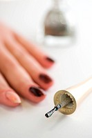 object on white _ female hand with a manicure