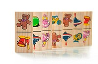 Children´s wooden dominoes on a light background