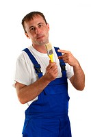 Craftsman with a yellow paintbrush in his hand