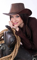 Super sexy brunette cowgirl on her saddle