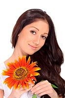 Young beautiful lady holding sunflower near face portrait