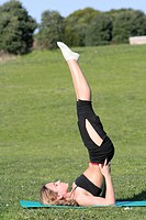 woman stretching in the park