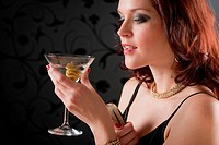 Cocktail party woman evening dress enjoy drink on black background