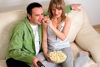 Couple relaxing at home and watching TV