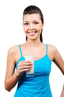 beautiful healthy young laughing woman with glass of milk