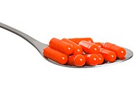 Medicine healthcare vitamin capsule pills in scoop