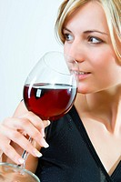 Young woman drinking red wine _ white background