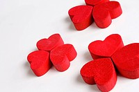 Red wooden hearts on a white background