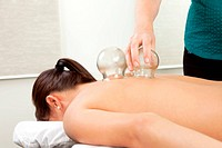 Woman receiving a cupping treatment at an acupuncture clinic
