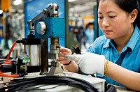 A factory employee clamping and soding the smaller parts of the switchgears. Shot in a switchgear factory that produces metal-clad draw-out type enclo...