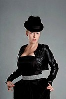 Blonde young woman in black leather jacket and hat