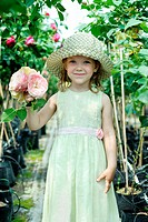 An image of a little girl with big roses