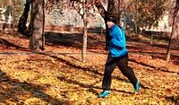 Man running in a park in autumn.
