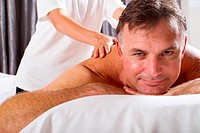 mature man having back massage at spa salon