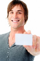 joyful man shoing a blank card towards camera