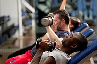 People working out with weights at health club