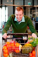 Portrait of a man pushing a grocery cart in a grocery store