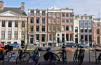 Amsterdam residential houses and bicycle. Spring cityscape