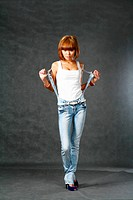 Beautiful Japanese girl in jeans over dark grey background