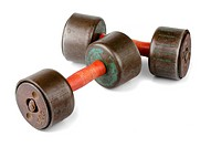 Pair of old rusty dumbbels isolated on white