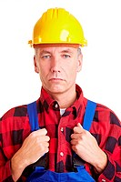 Eldery construction worker with yellow hard hat