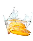 Bunch of bananas in water splash isolated on white background