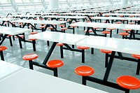 Tables and chairs in fast food cafe