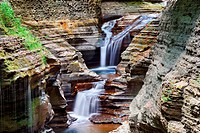 Watkins Glen waterfall in woods with rocks and stream in Watkins Glen state park in New York State