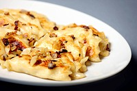 A close up of traditional Polish dumplings with fried onion