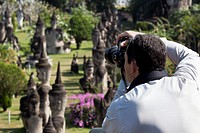 Photographer photographing sculpture park in Asia