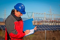 Engineer at Work In a Solar Power Station