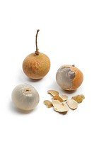 Whole and partial longan fruit isolated on white background
