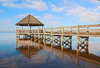 Public gazebo and dock with blue sky and white clouds over Whale Head Bay off of Currituck Sound on the Outer Banks near Corolla, North Carolina