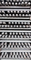 Many layers of metal machine bolts superimpossed