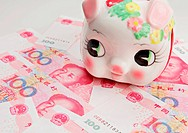 piggy bank on china banknote